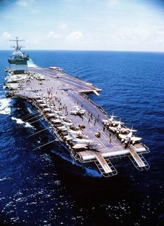 """The nuclear powered aircraft carrier USS Enterprise cruises in the clear blue water of the Gulf of Tonkin off the shores of Vietnam. With Skyhawk bombers on her bow, Enterprise is ready to recover more aircraft on her angled deck. 28 May Uss Enterprise Cvn 65, Navy Carriers, Navy Aircraft Carrier, Go Navy, Us Navy Ships, Naval History, United States Navy, Military Life, Military History"
