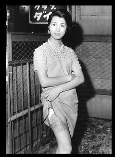 The subjects in Watanabe's photographs are the prostitutes, street people, Drag Queens, entertainers and gangsters (Yakuza) that populated Kabukicho at night.