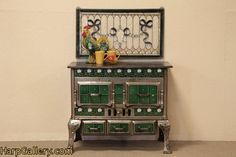 Antique iron stove with hand painted ceramic tile (France, 1890s)