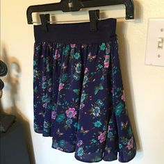 Forever21 Floral Skirt Navy with floral print skirt and elastic waist band Forever 21 Skirts