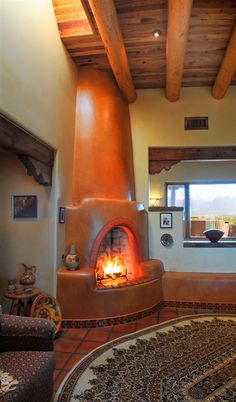 Love this orange adobe fireplace. The orange really magnifies the colors of the fire, and assures it stands out from the rest of the white walls. Southwest Style, Southwestern Home, Southwestern Decorating, Southwest Decor, Style At Home, Adobe Fireplace, Adobe Haus, New Mexico Homes, Spanish Style Homes