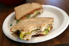 turkey veggie sandwich: turkey, avocado, tomato, and pickles with honey mustard on wheat bread