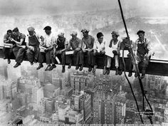 A very famous shot by Lewis Hine showing the construction workers at the Empire State Building construction site having lunch.