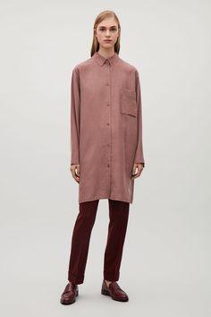 This shirt is made from soft mulberry silk with a slightly matte finish. A straight fit in an elongated length, it has dropped shoulders, high side splits at the hem and a clean button front.