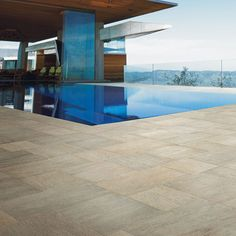 """Take a look at this dreamy pool and patio featuring Arizonatile.com Quarzite series in """"Grigia"""""""