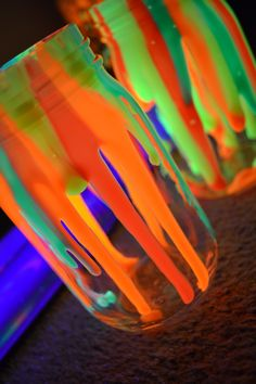 dripping neon paint jars