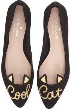 "Fanciful gold-lined cat ears detail the topline of these smart suede flats by Kate Spade finished with the shining words ""Cool Cat."""