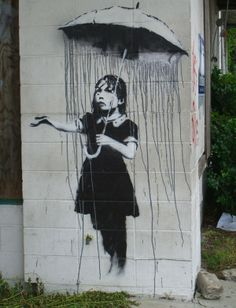 girl with umbrella by BANKSY