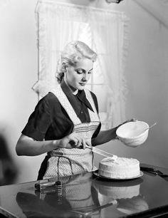 Homemaker frosting her evening cake, right before hubby arrives! 1950's / 1960's