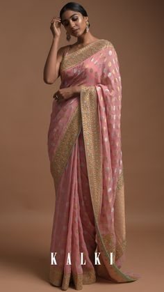Pretty in Peach has a perfect example in this saree. Striking a perfect balance between a ravishing attire and delicate embroidery that further enhances the beauty of this saree. Paired with these unique inverted drop pastel earrings, this combo is a sure show stealer.  Style Tip: Natural makeup with poker straight hair and pastel danglers. Saree Wearing Styles, Saree Styles, Lehenga Designs, Saree Blouse Designs, Sari Blouse, Indian Attire, Indian Outfits, Designer Sarees Wedding, Designer Sarees Online