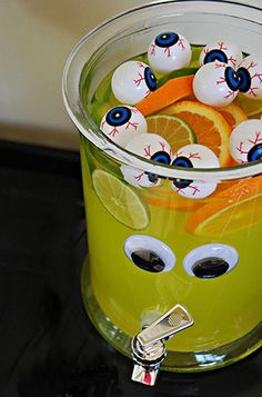 Eyeball Halloween Punch! Recipe here: http://ideas.evite.com/section/drinks/green-eyed-monster-punch/ #halloween
