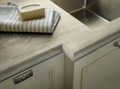 The best looking plastic laminate countertop I've ever seen - Formica's Travertine Silver with Ogee IdealEdge™