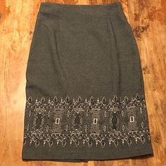 Adorable Gray zip back split skirt Cute gray skirt with zipper in back fun design on lower front with slit in the back. Pacific apparel collections Skirts