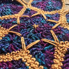 The inspiration for making this motif was a mixture of sources, including geometric mosaics and colorful yarns.