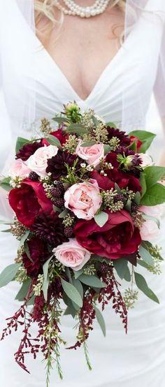 bouquet of burgundy Black Magic roses burgundy dahlias dusty blush Quicksand roses ivory spray roses burgundy astilbe seeded eucalyptus burgundy ranunculus silver dollar. Burgundy Wedding Flowers, Burgundy Bouquet, Cascading Wedding Bouquets, Rose Bridal Bouquet, Blush Bouquet, Dahlia Bouquet, Bride Bouquets, Bridal Flowers, Wedding Bouquets