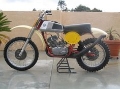 1976 CZ 400 I rode this beast for a while fast , but crude and heavy.. Actually at 220 pounds it was very light for it's time.