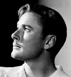 Image of Errol Flynn short hairstyle with thin mustache.
