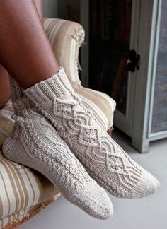 Nothing warms feet like a cozy pair of cabled socks. The prominent front cable, flanked by smaller twists, extends down to the toes. Twisted Stitch Socks by Manuela Burkhardt Knitting Stitches, Knitting Socks, Hand Knitting, Crochet Socks, Knit Or Crochet, Wool Socks, Knit Patterns, How To Wear, Slippers