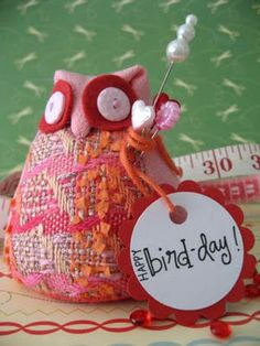pincushion and a great paper blog-very creative....loved visiting the blog.