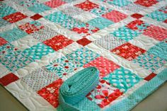 Love the colors and the quilting pattern. White in the middle of the nine patch brightens it up.