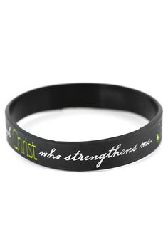 """Philippians 4:13 - Black Silicone Bracelet - Wrap an inspiring Bible verse on your wrist with this Philippians 4:13 - Black Silicone Bracelet with white lettering displaying the verse """"I can do all things through Christ who strengthens me."""" Wear this simple wristband to make a bold statement, or give it to someone who needs some encouragement. Part of a collection of great Christmas gifts."""