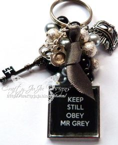 50 Shades Of Grey Key Chain..love this. the charms from the bracelet he gives her and the key to the playroom