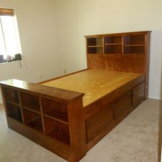 this is nice. I like the bookshelf headboard and footboard. needs sliding doors to store things underneath. or maybe just open