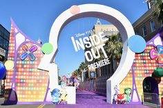 On June 9, Disney and Pixar premiered Inside Out at the El Capitan Theatre. A whimsical entrance outfitted with the movie's title hung over a purple arrivals carpet. Photo: Alberto E. Rodriguez/Getty Images for Disney