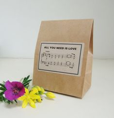 RUSTIC FAVOR BAGS IDEAL FOR WEDDING FAVOR BAGS/WEDDING FAVOUR BAGS/CANDY BAR 7 X 3 X 2 - FOLDS DOWN TO SIZE REQUIRED BEATLES MUSIC - ALL YOU NEED IS LOVE BAGS HAVE FLAT BOTTOM AND STAND ALONE INEXPENSIVE, CLASSY AND FUN!!  IF YOURE LOOKING FOR WEDDING FAVOR BAGS/CANDY BAR BAGS THAT ARE DIFFERENT - THESE STAND ALONE FAVOR BAGS ARE IDEAL!! MADE FROM STRONG KRAFT PAPER - THEY COME READY TO FILL WITH CHOCOLATES/SMALL GIFTS ETC. EACH BAG HAS A BEATLES MUSIC SCORE/ALL YOU N...