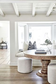 A Los Angeles Home That Perfectly Mixes Classic and Serene bright white dining room with round table and built in bench seating Minimalist Dining Room, Minimalist Home Decor, Modern Minimalist, Minimal Decor, Minimalist Living, Minimalist Interior, Coastal Living Rooms, Living Room Decor, Coastal Cottage