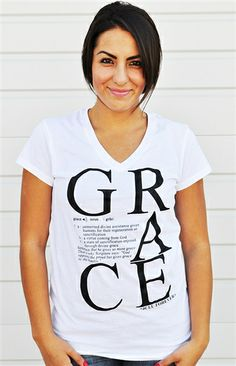 $10.00 today! Grace defined is the word itself spelled out with giant letters and placed in a stacked formation. On the shirt you'll also see the actual dictionary definition of the word Grace and the scripture James 4:6 as the sentence example.