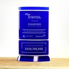 Blue Crystal Reflection Award customized as Financial Tombstone. These pieces can be customized and delivered within 10 business days. Rush service available! Tombstone Designs, Crystal Awards, Blue Crystals, Timeless Design, Reflection, Toys, Best Deals, Business, Activity Toys