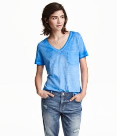 Over-dyed top in washed cotton jersey with a V-neck and one chest pocket.