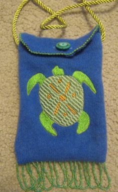 felted sweater purse with embroidered turtle and hand beaded trim.