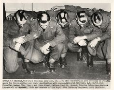 "1951- Canadian troops of the Royal 22nd Infantry Regiment, shown at Seattle embarkation port before shipping out to Korea, spell out ""Korea"" with custom-tailored haircuts."