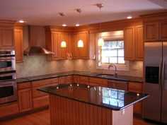 oak cabinets with black countertops - Google Search