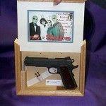 Secret compartment picture frame concealing gun