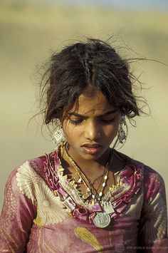 Portrait of young girl with traditional jewels. India by Bank World Photo Colection