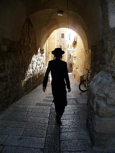 Chassid walking through the streets of the old city - Jerusalem, Israel