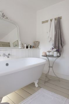 Traditional bathroom with t panels and free standing bath