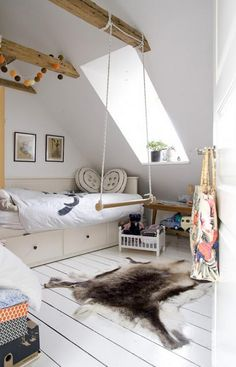 love the wooden beams and swing in this modern scandinavian kids bedroom