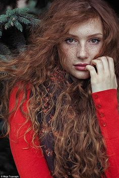 Models with varying intensities of red hair are photographed in the stunning…