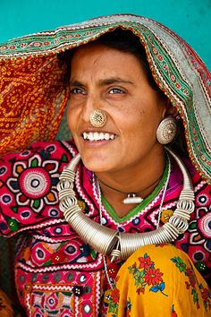 India | Portrait of a woman from the Marwada Meghwal Harijan tribe wearing traditional clothing in the village of Bhirendiara, located roughly 50km from Bhuj in the Kutch District. Gujarat  | © Kimberley Coole