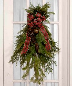 A nice change from a circular wreath.  DIY directions from Country Sampler magazine
