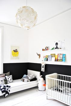 Black and white nursery with small book shelf