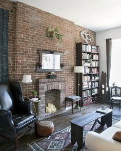This generally looks like our place. Kyle wants to put the (currently non-existent) bookshelf up against the brick wall. I thought it would block the exposed brick but I dig this!