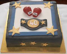 Boxing ring 40th birthday cake made with a layered chocolate sponge, boxing glove, belt & stars