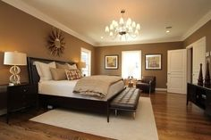 Master Bedroom - Relaxing in warm neutrals and luxurious bedding More
