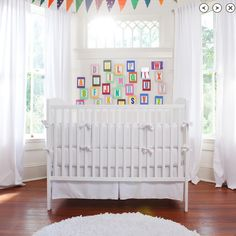 Simple crib in a room with great architectural details and fun decorations.