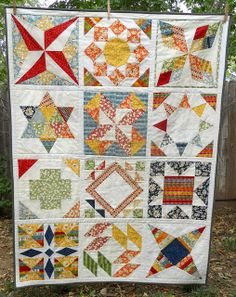 sampler quilt but in our colors.  I like the giant sampler blocks, and Zac likes the white sashing.